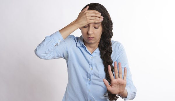 Woman or person with showing obvious physical body language indicating stress